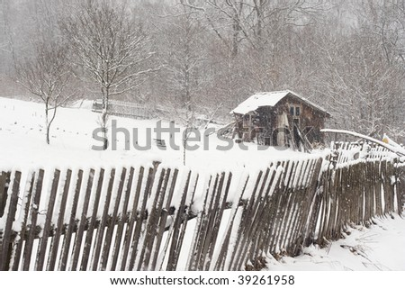 Shed in the winter scenery, Bieszczady Mountains near Orelec, Poland - stock photo