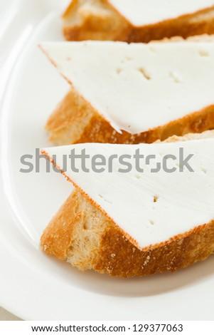 "Sheep cheese tapas called ""Queso de cabra"" in Spain. - stock photo"