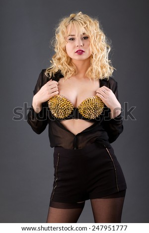 Sheer blouse with fashion bra - stock photo