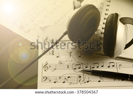Sheet music with a number of accessories - stock photo