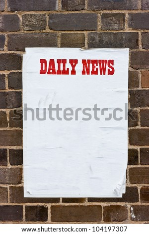 Sheet of  creased, blank white paper curled at the edges pasted to a brick wall with header printed in bright red letters in caps the words DAILY NEWS.  - stock photo