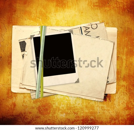 Sheet of old paper and photo on stucco wall - stock photo