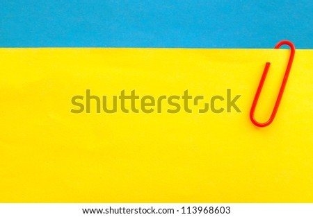sheet of paper for notes and paper clip - stock photo