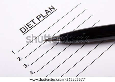 sheet of paper with diet plan and metal pen - stock photo