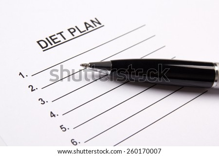sheet of paper with diet plan and pen - stock photo