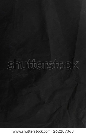 Sheet of the black industrial wrinkled paper  - stock photo