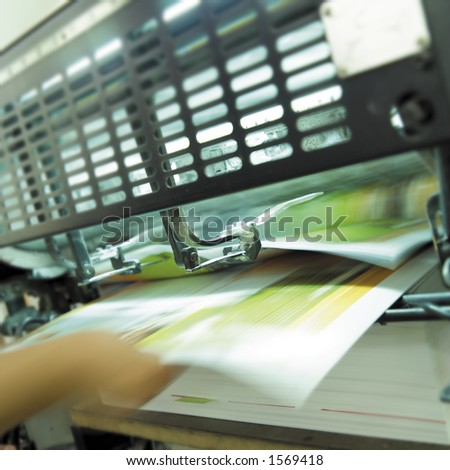 Sheet pulled from printing press. - stock photo