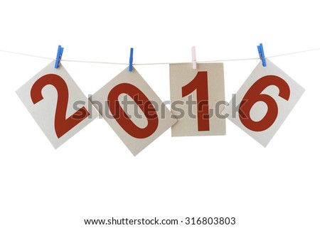Sheets of a cardboard with numbers 2016 (New year of Two thousand sixteen ) hanging on a clothesline. Isolated on a white background - stock photo