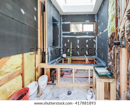 Sheets of foam-filled waterproof board are attached to the studs and fasteners are waterproofed with sealant - stock photo