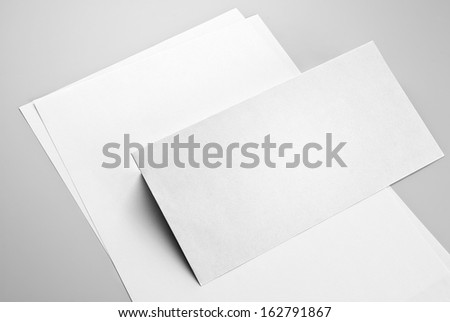 Sheets of paper and envelope - stock photo