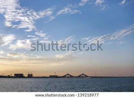 Sheikh Isa Bin Salman causeway Bridge during sunset - stock photo