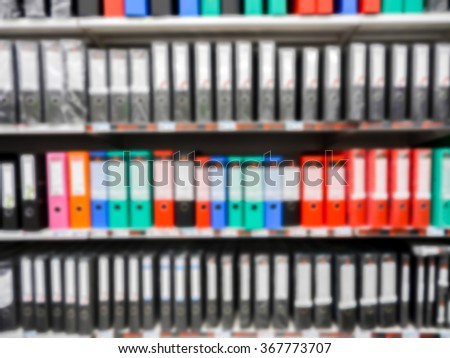 Shelf in a office with many files blur background - stock photo