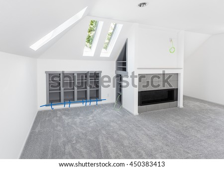 Shelf inserts for books and electronics installed into wall and cavity behind new fireplace - stock photo