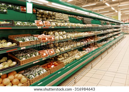 Shelf with citrus fruits, TMs and bar codes removed or altered, toned image - stock photo