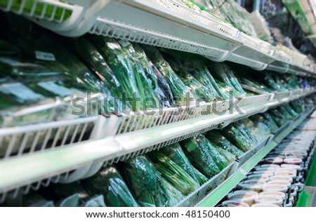 Shelf with fresh herbs in big supermarket, shallow focus - stock photo