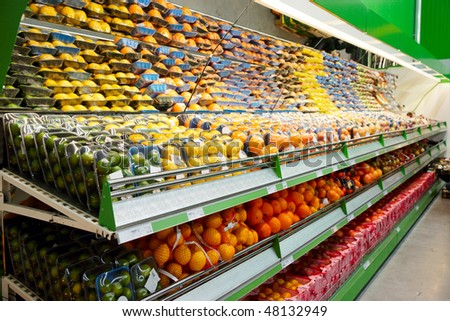 Shelf with fruits, TM's removed, price tags left in place and contain no copyright. - stock photo