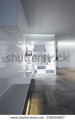 Shelf with lamp in modern house interior - stock photo