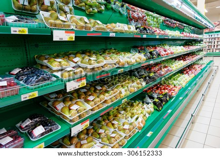 Shelf with vegetables, trademarks removed, price tags contain no copyright - stock photo