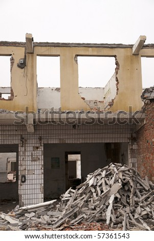 Shell of a demolished building - stock photo
