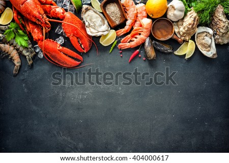 Shellfish plate of crustacean seafood with fresh lobster, mussels, oysters as an ocean gourmet dinner background - stock photo