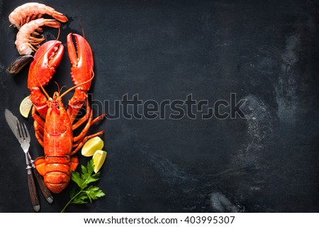 Shellfish plate of crustacean seafood with fresh lobster, mussels, shrimps as an ocean gourmet dinner background - stock photo
