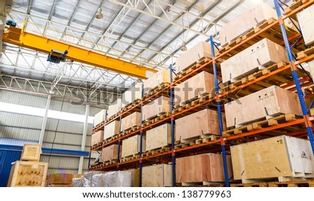 Shelves and racks in distribution warehouse interior - stock photo
