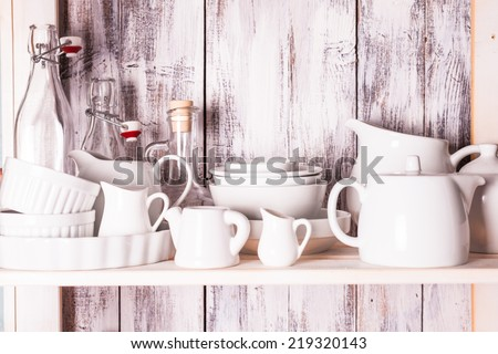 Shelves in the rack in the kitchen at shabby chic style - stock photo