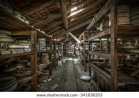 Shelves of clay moulds at an abandoned ceramics factory, HDR processing - stock photo