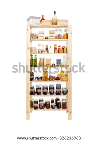 Shelves of homemade preserves and canned goods - stock photo
