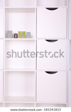 Shelves with decorative letter close up - stock photo