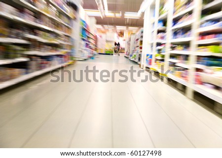 Shelves with goods inside a large supermarket - stock photo