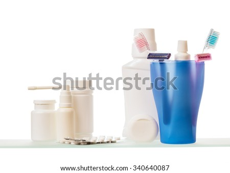 Shelves with medicine and toothbrushes on a white background - stock photo