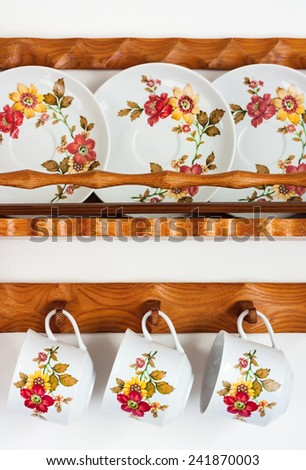 shelves with painted cups on a plate - stock photo