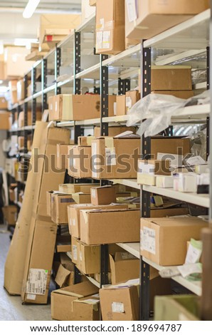 Shelves with parcels in the post office. - stock photo