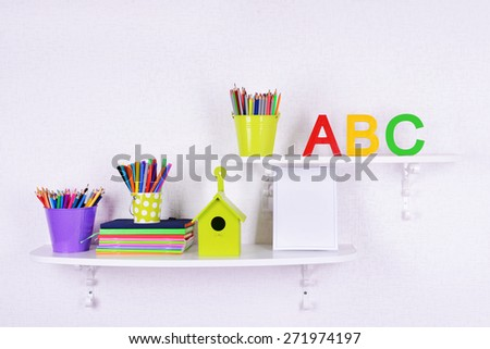 Shelves with stationery in child room close-up - stock photo