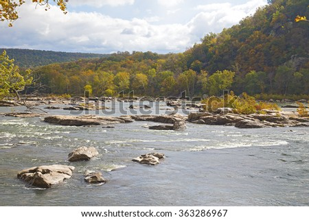 Shenandoah River along Appalachian trail in West Virginia, USA. Rocky river in early autumn near Harpers Ferry historic town of West Virginia. - stock photo