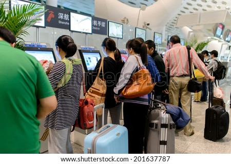 SHENZHEN - APRIL 16: airport interior on April 16, 2014 in Shenzhen, China. Shenzhen Bao'an International Airport is located near Huangtian and Fuyong villages in Bao'an District, Shenzhen, Guangdong - stock photo