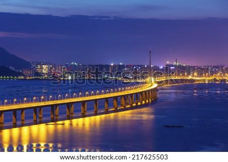 Shenzhen bridge in Hong Kong at night - stock photo