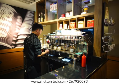 SHENZHEN, CHINA - FEBRUARY 16, 2015: Costa Coffee cafe interior. Costa Coffee is a British multinational coffeehouse company headquartered in Dunstable, United Kingdom. - stock photo