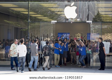 SHENZHEN, CHINA - NOV. 3:  Customers walking into the new Apple store. Apple open its seventh Apple store in mainland China, located in SHENZHEN, November 3, 2012. - stock photo