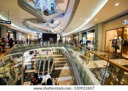 SHENZHEN, CHINA - OCTOBER 15, 2015: KK Mall shopping mall interior. KK Mall is high-end shopping mall in Shenzhen, within walking distance of both Citic Plaza and MixCity. - stock photo