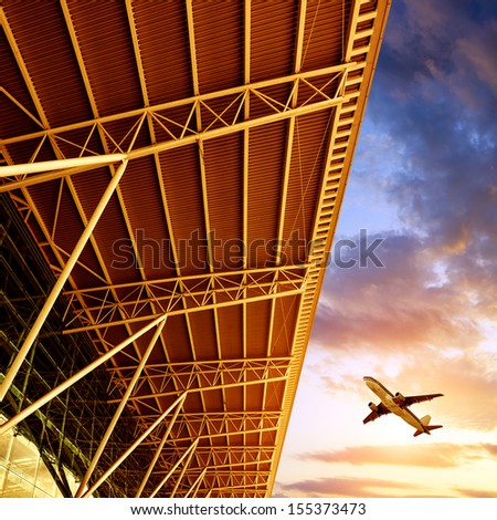 Shenzhen International Airport airplane on the sky - stock photo