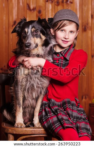 Shepherd girl sitting next to his beloved dog breed border collie on the farm - stock photo