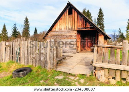 Shepherd wooden hut on meadow in autumn season - stock photo
