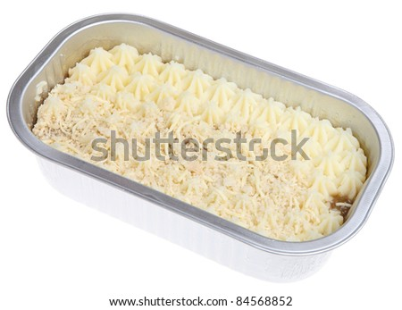 Shepherds pie convenience meal in foil container. Uncooked. - stock photo