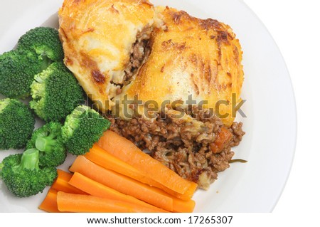 Shepherds pie with carrots and broccoli - stock photo