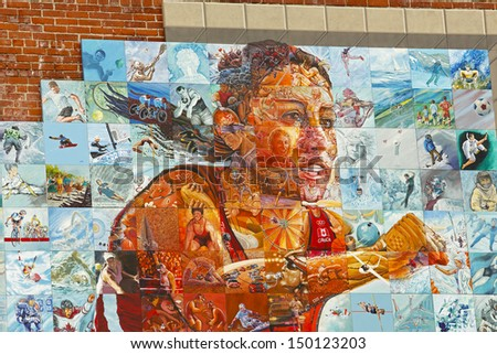 SHERBROOKE, CANADA - August 6: A portion of the National Mural Mosaic of the Canada Games August 6, 2013 in Sherbrooke, Canada. - stock photo