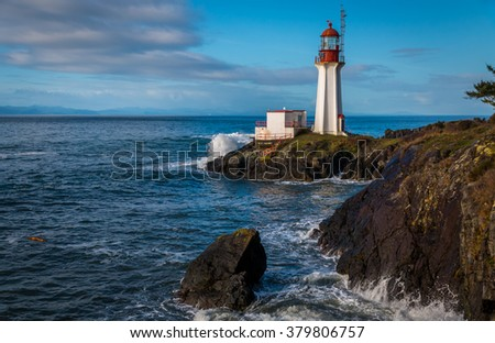 Sheringham Lighthouse  on Vancouver Island British Columbia Canada on a beautiful spring morning. - stock photo