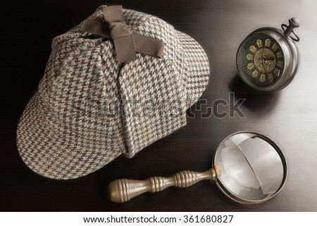 Sherlock Holmes Deerstalker Hat And Vintage Clock And   Magnifying Glass On The Black Wooden Table Background. Overhead View.  Investigation Concept. - stock photo