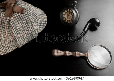 Sherlock Holmes Deerstalker Hat, Vintage Clock, Retro Magnifier And Smoking Pipe On The Black Table Background. Overhead View.  Investigation Concept. - stock photo
